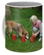 Girl Playing With Dog Coffee Mug by Mark Taylor