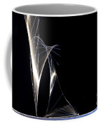 High Speed Strobe Image Of Pin Dropping Coffee Mug