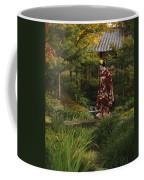 Kimono-clad Geisha In A Park Coffee Mug by Justin Guariglia