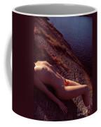 Nude Woman Lying On Rocks By The Water Coffee Mug