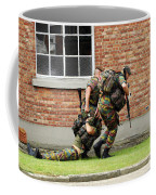 Soldiers Of The Belgian Army Helping Coffee Mug by Luc De Jaeger