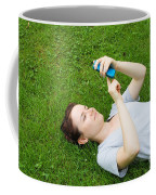 Woman Using Her Iphone Coffee Mug by Photo Researchers, Inc.