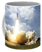 Space Shuttle Atlantis Lifts Coffee Mug