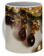 3 Hanging Semi-precious Stones Attached To A Green And Gold Necklace Coffee Mug
