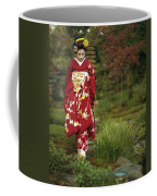 Kimono-clad Geisha In A Park Coffee Mug by Justin Guariglia