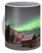 Aurora Borealis Over A Cabin, Northwest Coffee Mug