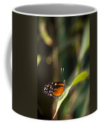 A Butterfly Rests On A Leaf Coffee Mug