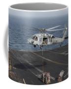 A Mh-60s Knighthawk Conducts A Vertical Coffee Mug