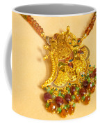 A Beautiful Intricately Carved Gold Pendant Hanging From A Semi-precious Stone Chain Coffee Mug