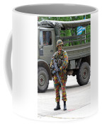 A Belgian Infantry Soldier Handling Coffee Mug by Luc De Jaeger