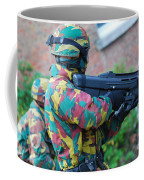 A Belgian Paratrooper  Handling The Fn Coffee Mug by Luc De Jaeger