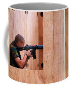 A Belgian Soldier Trying Out A Shooting Coffee Mug by Luc De Jaeger