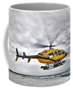 A Bell 407 Utility Helicopter Prepares Coffee Mug