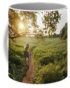 A Bicyclist Rides On A Path Coffee Mug by Skip Brown