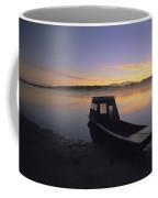 A Boat Sits On The Calm Yukon River Coffee Mug by Michael Melford