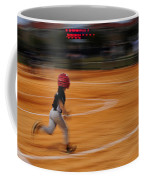 A Boy Runs During A Baseball Game Coffee Mug by Raul Touzon