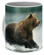 A Brown Bear Rushing Through Water Coffee Mug