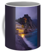 A Building Illuminated At Night Along Coffee Mug
