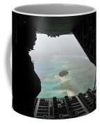 A Bundle Of Donated Goods Drifts To An Coffee Mug
