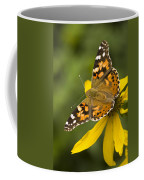 A Butterfly Sits Atop A Yellow Coffee Mug