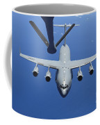 A C-17 Globemaster IIi Approaches Coffee Mug by Stocktrek Images