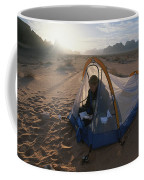 A Camper Reading In Her Tent Coffee Mug by Gordon Wiltsie
