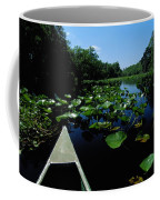 A Canoe Floats On A River Filled Coffee Mug