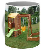 A Childs Playing Equipment In A Green Location Coffee Mug