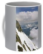 A Climber Walks Along A Steep Slope Coffee Mug