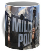 A Close-up View Of Marines Holding Riot Coffee Mug