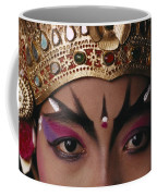 A Close View Of A Face Of A Balinese Coffee Mug