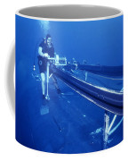 A Crewman Cranks Out The Dry Deck Coffee Mug by Michael Wood