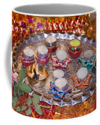 A Decorated Hindu Prayer Thaali With Wax Candles Oil Lamps Coffee Mug