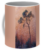 A Desert Bloodwood Tree Against The Red Coffee Mug by Jason Edwards