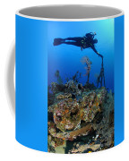 A Diver Hangs On To A Piece Of Ww2 Coffee Mug