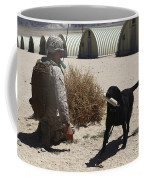 A Dog Handler Calls Over A Black Coffee Mug by Stocktrek Images