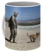 A Dog Handler Conducts Improvised Coffee Mug by Stocktrek Images