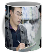 A Factory Employees Discuss Textile Coffee Mug by Justin Guariglia