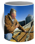 A Farmer Watches As His Corn Is Augered Coffee Mug by Joel Sartore
