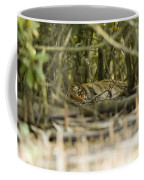 A Female Tiger Rests In The Undergrowth Coffee Mug