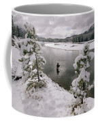 A Fisherman Tries His Luck Coffee Mug by Annie Griffiths
