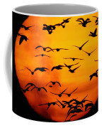 A Flock Of Geese Is Silhouetted Coffee Mug