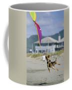 A German Shepherd Leaps For A Kite Coffee Mug