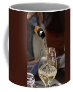 A Glass Of White Wine Being Poured Coffee Mug