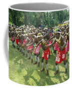 A Group Of New Guinean Men Performing Coffee Mug by Klaus Nigge
