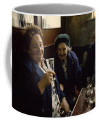 A Group Of Old Friends Gathers Coffee Mug by Cotton Coulson
