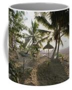 A Hammock, Umbrella, And Swaying Palms Coffee Mug