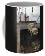 A Harbor Crane Lifts A Mine-resistant Coffee Mug