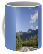 A Highway Winds Through The Mountains Coffee Mug by Taylor S. Kennedy
