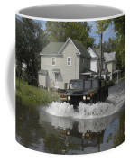 A Humvee Drives Through The Floodwaters Coffee Mug